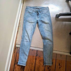 Light wash american eagle skinny jegging jeans